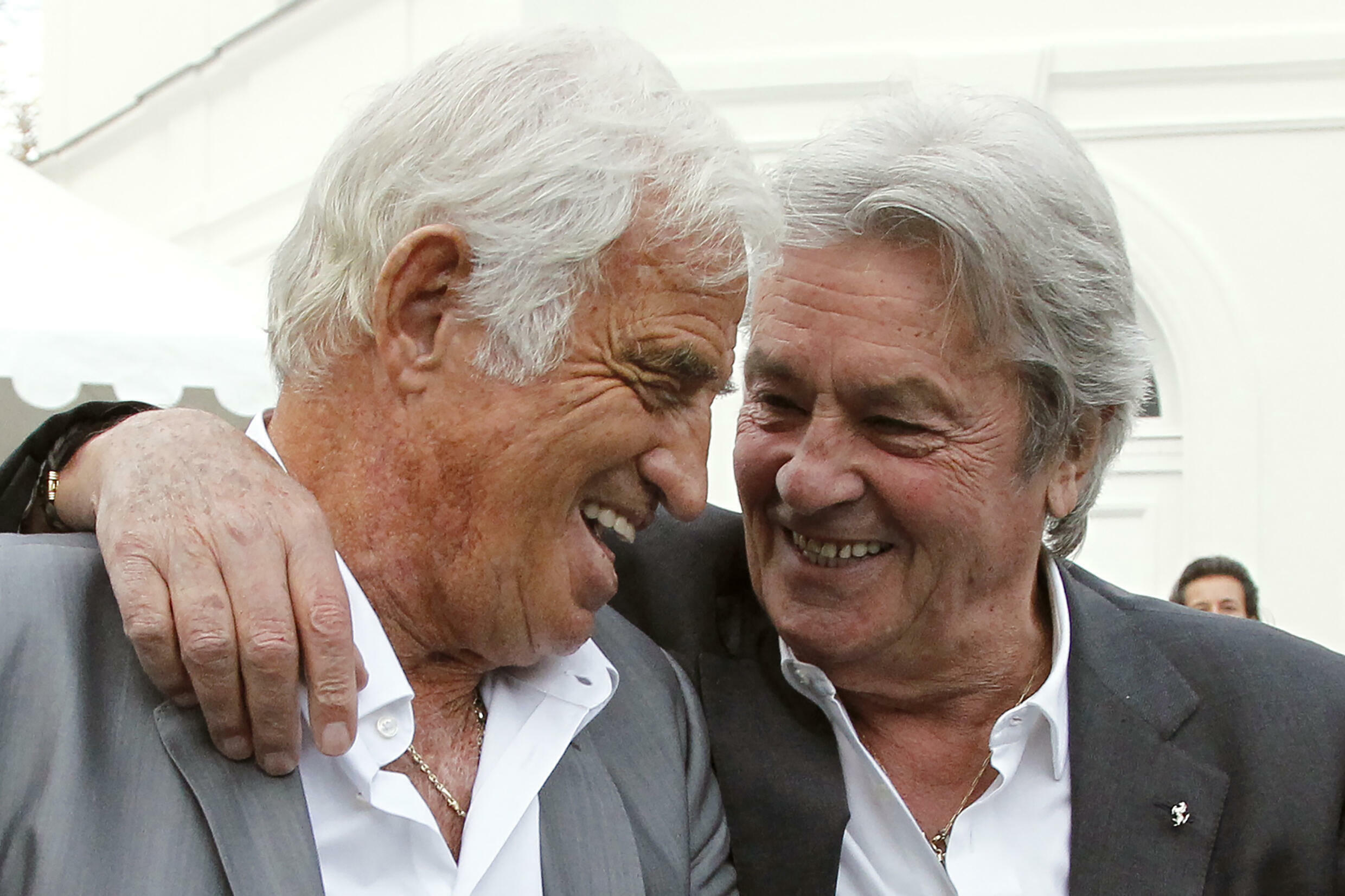 The actors Jean-Paul Belmondo (left) and Alain Delon laugh during the inauguration of the Paul Belmondo museum, dedicated to the father of the first, on September 14, 2010 in Boulogne-Billancourt, in the outskirts of Paris