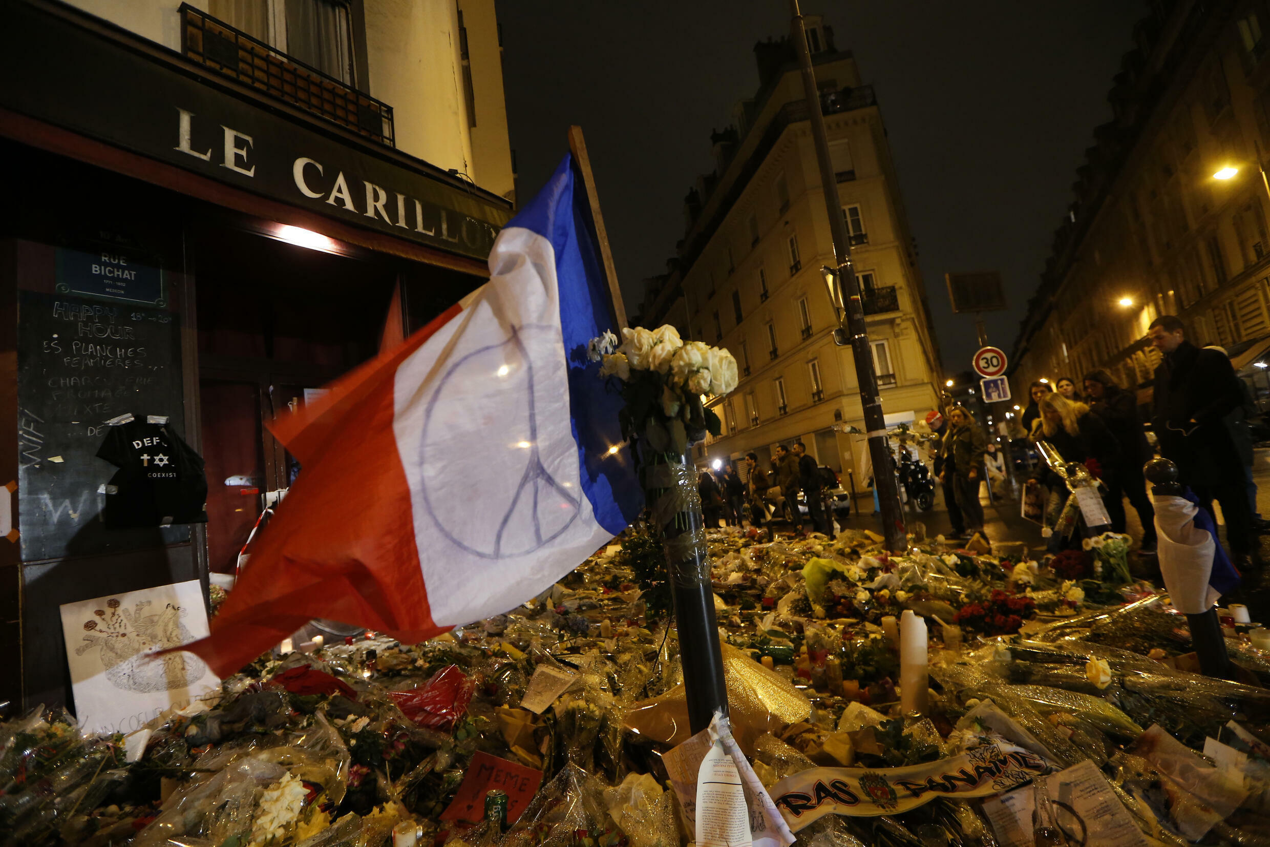 A makeshift memorial outside the Carillon bar in Paris, one of the sites of carnage on November 13, 2015