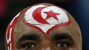 A Tunisia fan looks on during their Group B soccer match against Democratic Republic of Congo