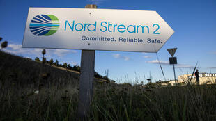 A sign directs traffic towards the Nord Stream 2 gas line landfall facility entrance in Lubmin, Germany in September 2020