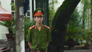 Une douzaine de policiers vietnamiens sont retenus en otage par des paysans en colère. (photo d'illustration)