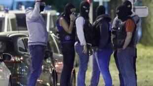French policemen take part in a police raid in Boussy-Saint-Antoine near Paris, France, September 8, 2016.