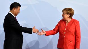 Thủ tướng Đức Angela Merkel và chủ tịch Trung Quốc Tập Cận Bình tại thượng đỉnh G20 Hambourg, Dức, ngày 07/07/2017.