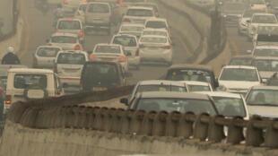 Vehicles drive among the smog in New Delhi, India, November 2, 2019.