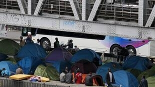African migrants from a makeshift camp beneath the metro in Paris, 29 May 2015.