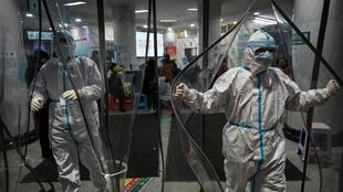 China's isolation grows as virus toll reaches 259. AFP / Anthony WALLACE