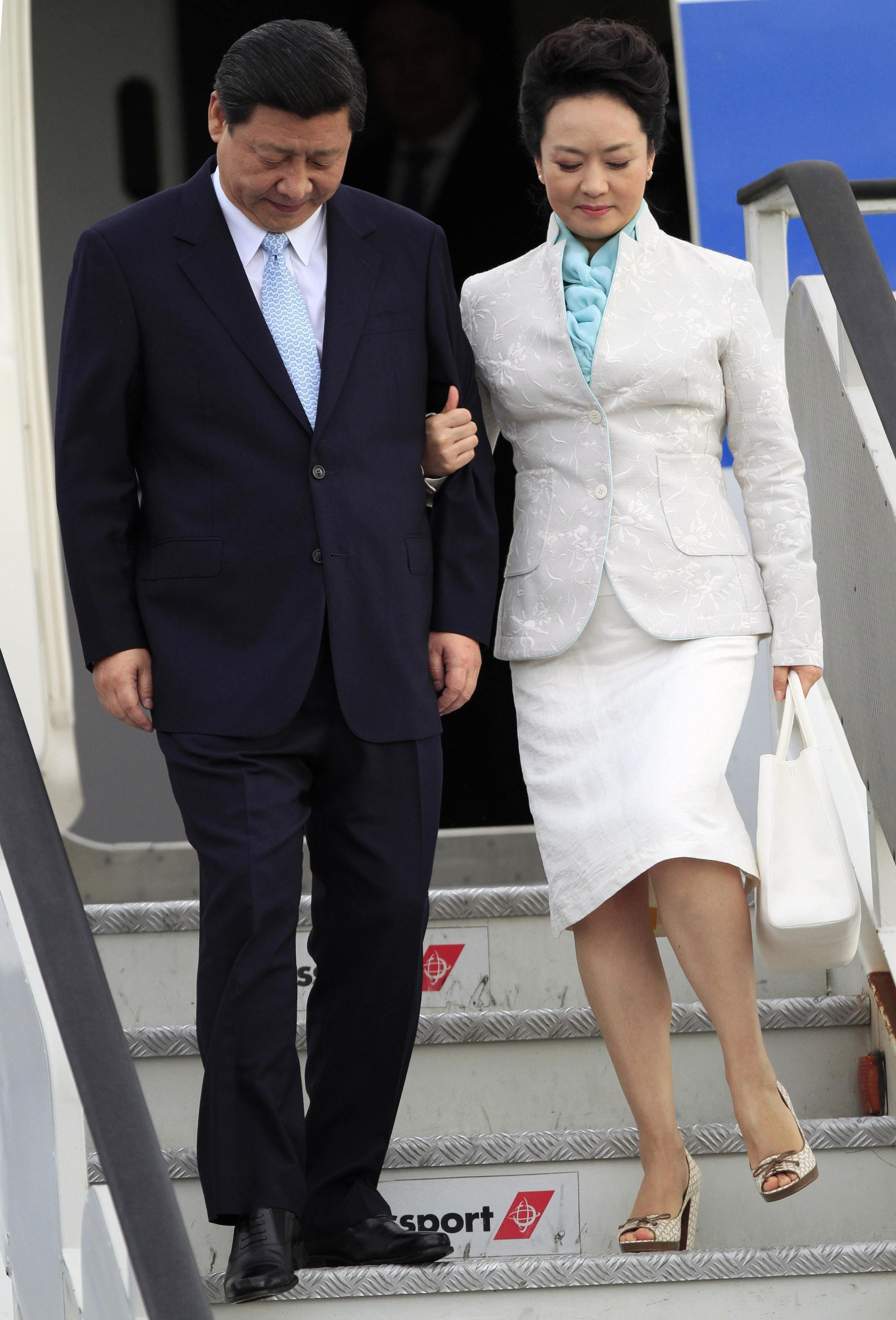 El presidente chino Xi Jinping y su esposa Peng Liyuan en marzo pasado