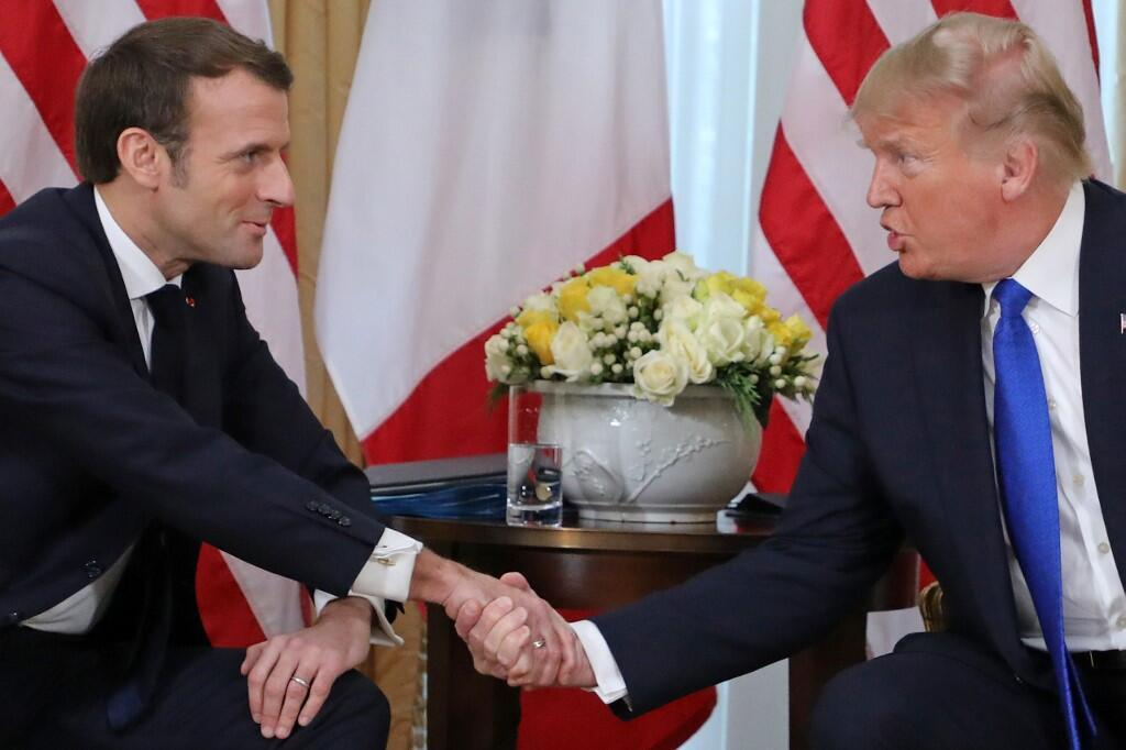 US President Donald Trump and France's President Emmanuel Macron shake hands during their meeting at Winfield House, London on 3 December, 2019 on the sidelines of the NATO summit