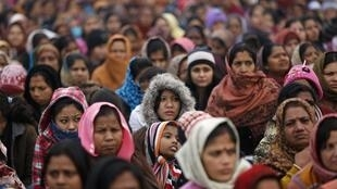 Women attend a prayer ceremony for a rape victim after a rally protesting for justice and security for women in New Delhi.