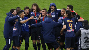 Paris Saint-Germain's players jubilate at the end of the French League Cup final football match between Paris Saint-Germain and Lille on April 23, 2016 at the Stade de France in Saint-Denis, north of Paris
