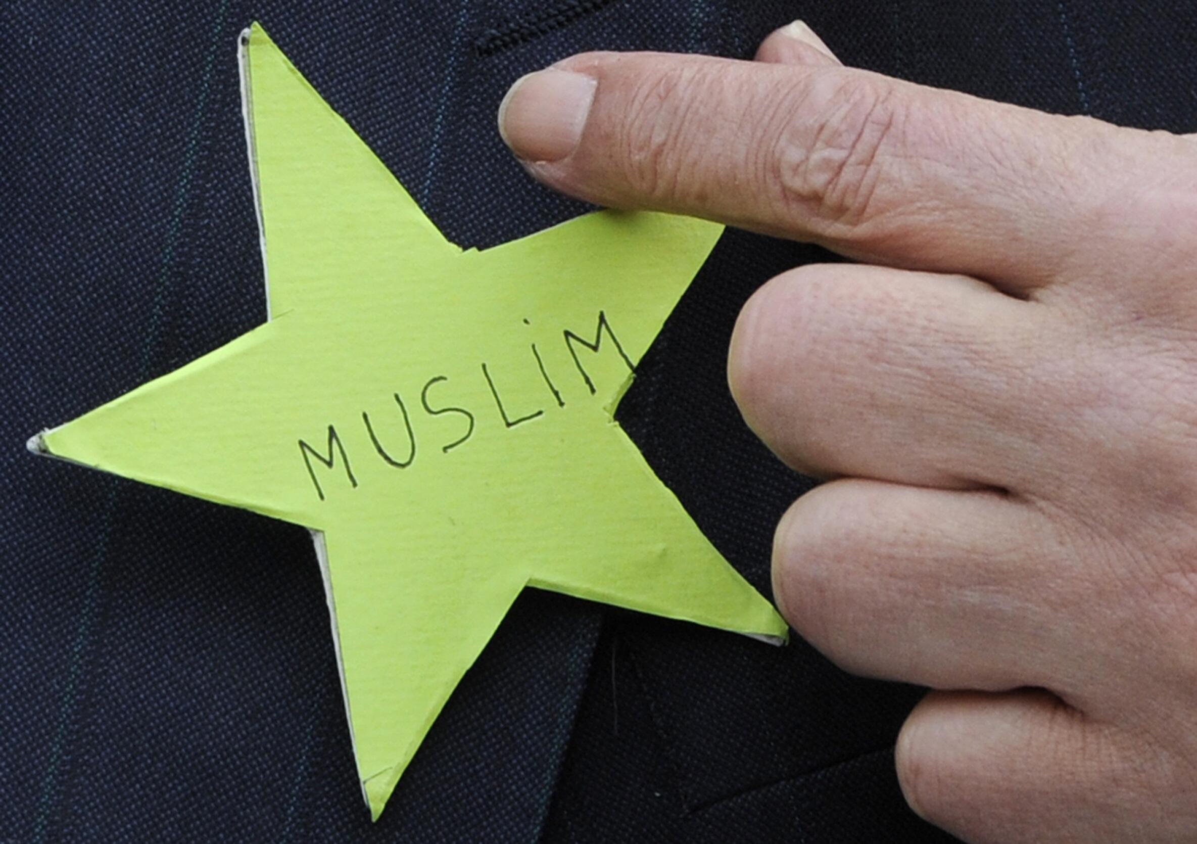 Former Sarkozy adviser Abderrahmane Dahmane with a green star, recalling anti-Semitism, in protest at the secularism debate