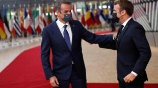French president Emmanuel Macron greets Greek prime Kyriakos Mitsotakis (L) Brussels,1st October