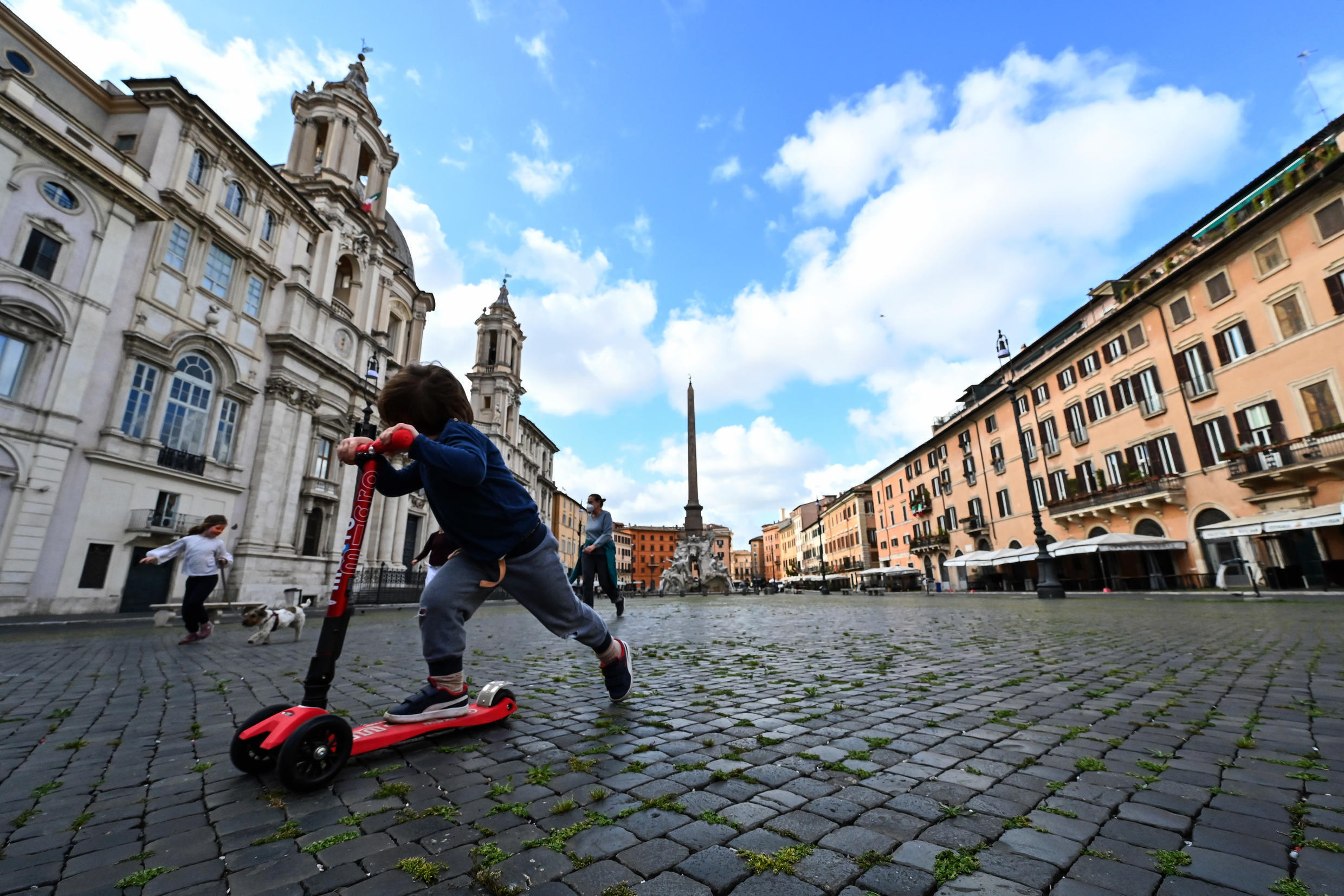 Young children play in the streets of Rome, Italy, as the country gradually lifts lockdown, 4 May 2020.