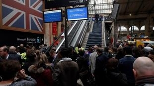 Delayed passangers wait for a Eurostar train in Paris