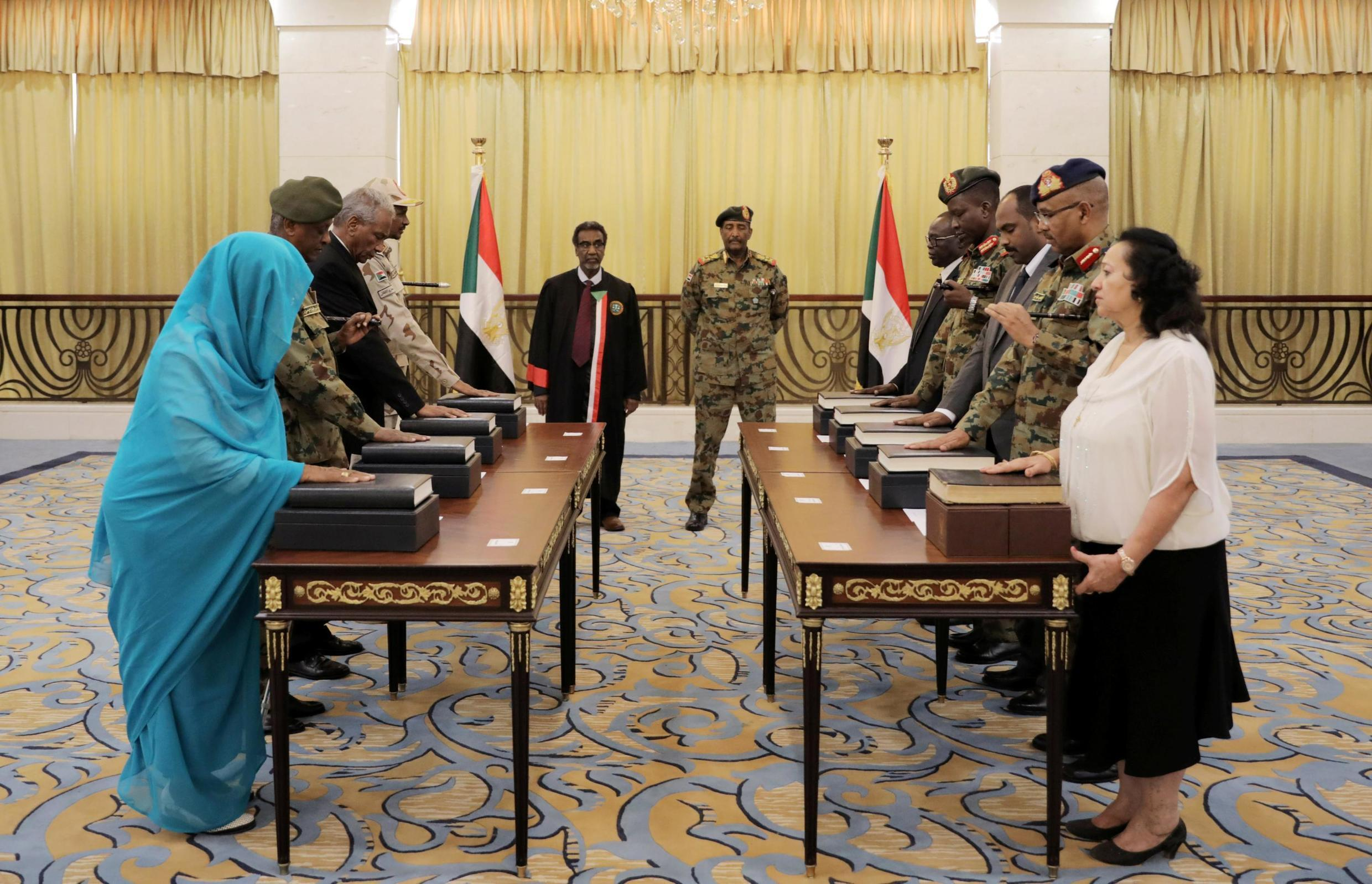 Lieutenant General Abdel Fattah Al-Abdelrahman Burhan looks on as military and civilian members of Sudan's new ruling body, the Sovereign Council, are sworn in at the presidential palace in Khartoum, 21 August 2019