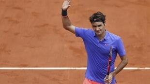 Roger Federer won his first round match at Roland Garros before being approached on court by a fan.