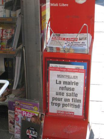 Tờ Midi Libre nói về sự kiệnTòa Thị chính Montpellier không tạo điều kiện cho việc chiếu bộ phim của ông André Menras. Ảnh chụp tại một kiosque bán báo.
