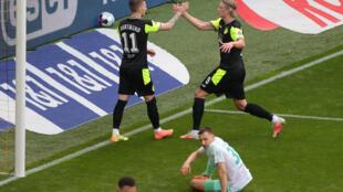 Haaland (R) celebrates with Dortmund captain Reus after scoring in Sunday's 4-1 home win against Werder Bremen