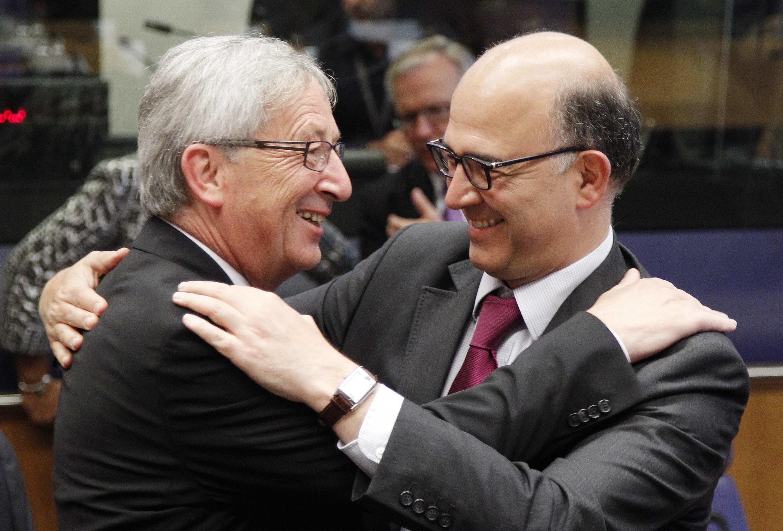 Председатель Еврогруппы, премьер-министр Люксембурга Жан-Клод Юнкер и министр экономики Франции Пьер Московиси