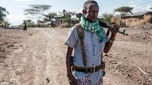 A militiaman in Ethiopia's Tigray region in December 2020. Not enough aid is being allowed in, the UN has warned