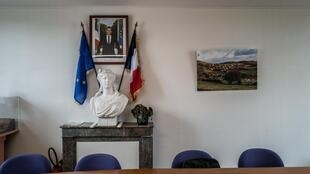 French and European flags either side of La Marianne and the official portrait of French President Emmanuel Macron in the town hall of Baubigny, a village in central France that has no candidate for the upcoming local elections.