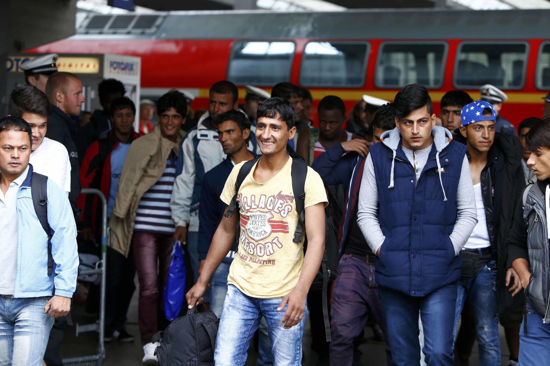 Des migrants à leur arrivée à la gare de Munich, le 7 septembre, 2015.
