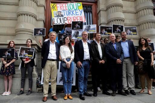Director General of Reporters Without Borders Christophe Deloire, Loic Bureau, father of Loup Bureau, and Mayor of Paris' 4th district Christophe Girard, attend a rally in Paris in support of French journalism student on 24 August, 2017.