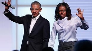 US president Barack Obama and his wife Michelle wave as they exit the stage during the Obama Foundation Summit in Chicago.