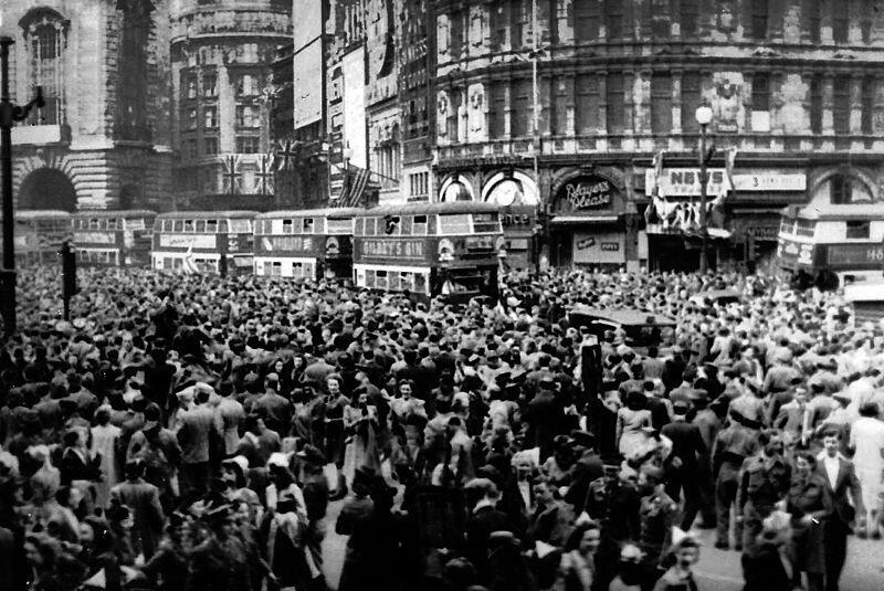 Piccadilly Square pictured as supporters celebrate VE Day, on 8 May 1945. Photo taken by Sgt. James A. Spence, during his service in World War II.