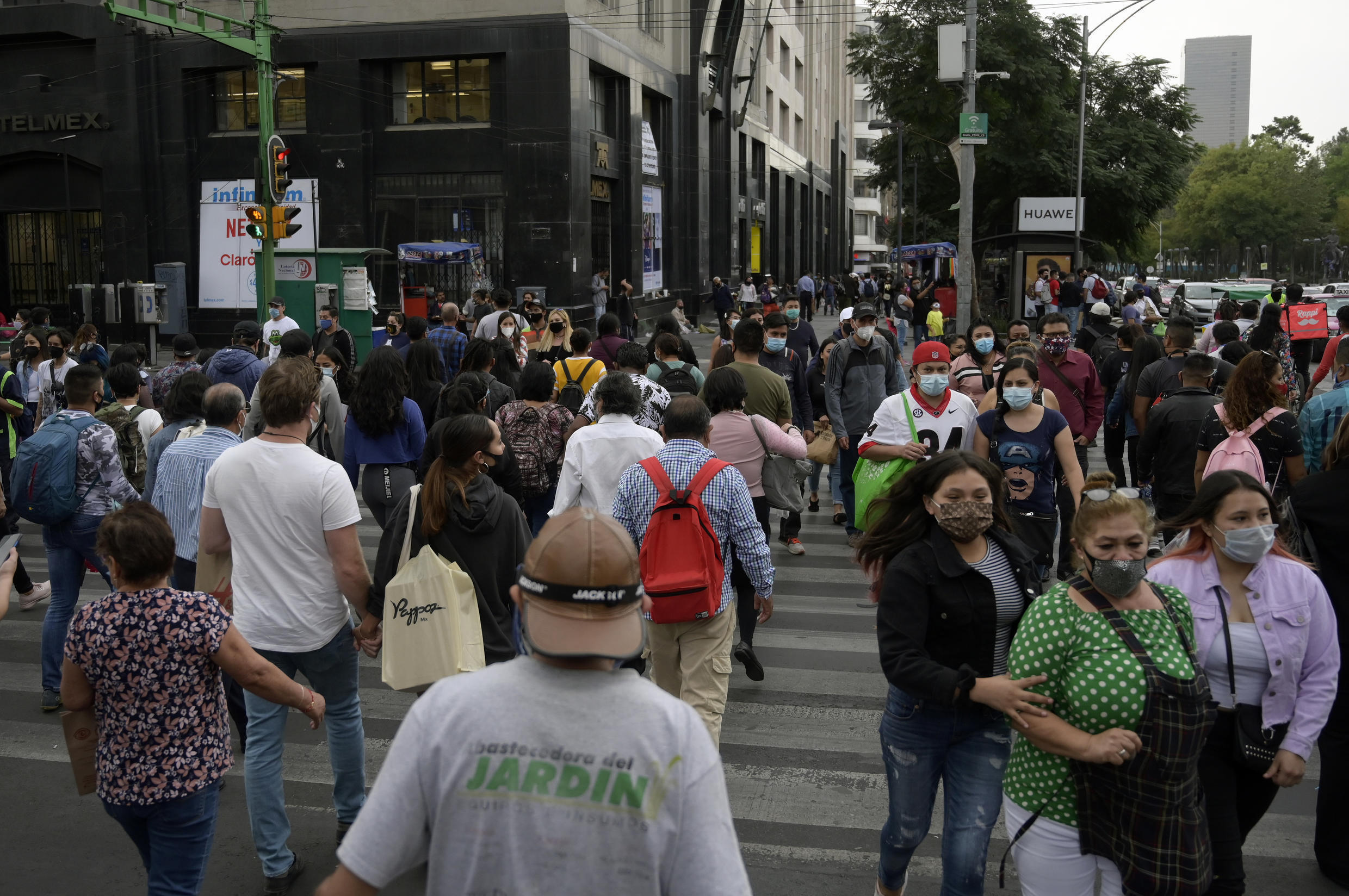 People walk in downtown Mexico City on December 16, 2020, amid the Covid-19 pandemic