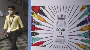 A doctor walks out of a Covid-19 vaccination centre in Mumbai. India's financial capital is in the middle of a coronavirus surge