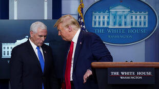 A senior to aide to US vice-president Mike Pence (left) returned a positive test for the coronavirus a day after one of President Donald Trump's staff also tested positive for the illness.