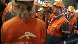 French President François Hollande visits the Florange steelworks, where his government failed to prevent the closure of a blast furnace
