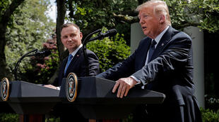 Poland's President Andrzej Duda listens to U.S. President Donald Trump during a joint news conference in the Rose Garden at the White House in Washington, U.S., June 24, 2020