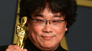 """Parasite"" director Bong Joon-ho poses with one of the four Oscars his film won in 2020, including best picture"