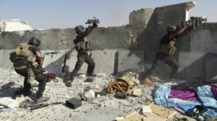 Vikosi maalumu vya Iraq vikipambana, Juni 19 mwaka 2014.