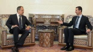 El presidente sirio, Bachar el-Assad, y el canciller ruso, Serguei Lavrov, durante una entrevista en febrero de este año