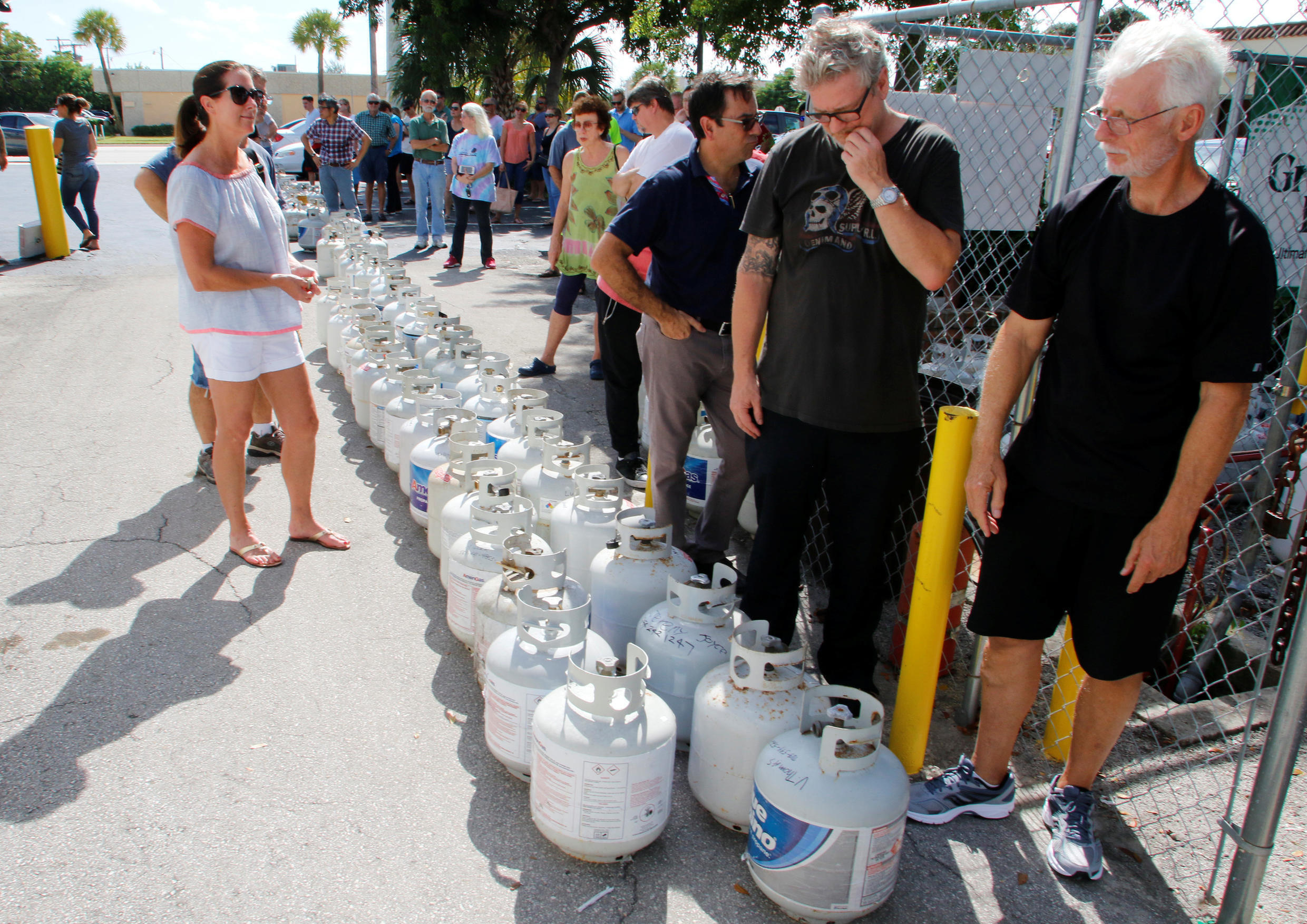 Residents wait in line to purchase propane gas at Lee's Barbecue Center in Boca Raton, Florida, as they continue to prepare for Hurricane Irma's expected arrival, September 6, 2017. Residents.