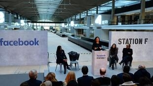 Facebook Chief Operating Officer Sheryl Sandberg with Xavier Niel at Station F headquarters in Paris on January 17, 2017.