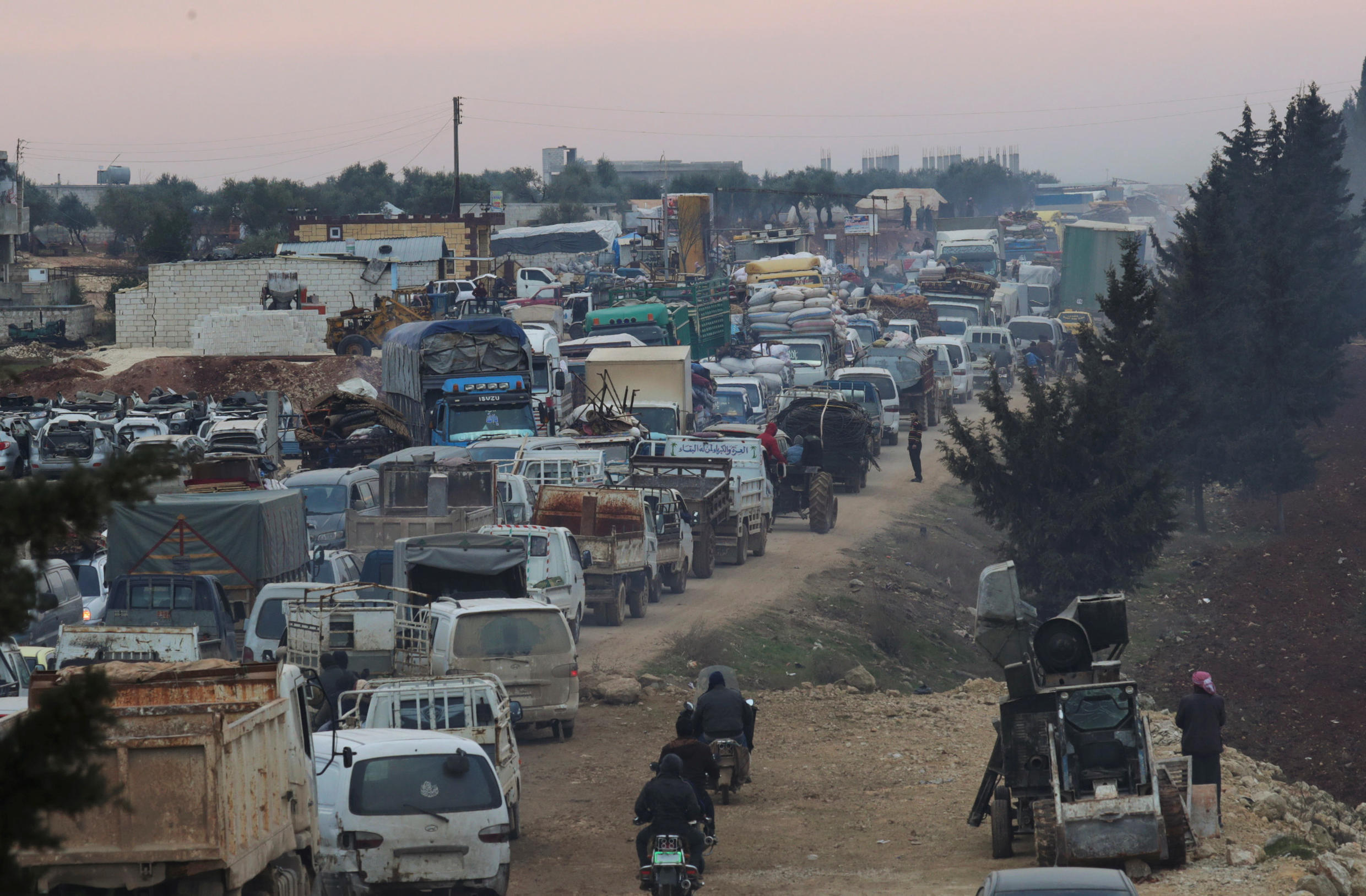 A general view of trucks carrying belongings of displaced Syrians, is pictured in the town of Sarmada in Idlib province, Syria, January 28, 2020.