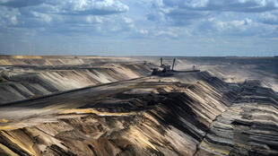 Protesters argue that the demolition of villages to enlarge the Garzweiler II brown coal mine in North Rhine-Westphalia state violates locals' constitutional rights and is at odds with the government's pledge to ditch the polluting fossil fuel