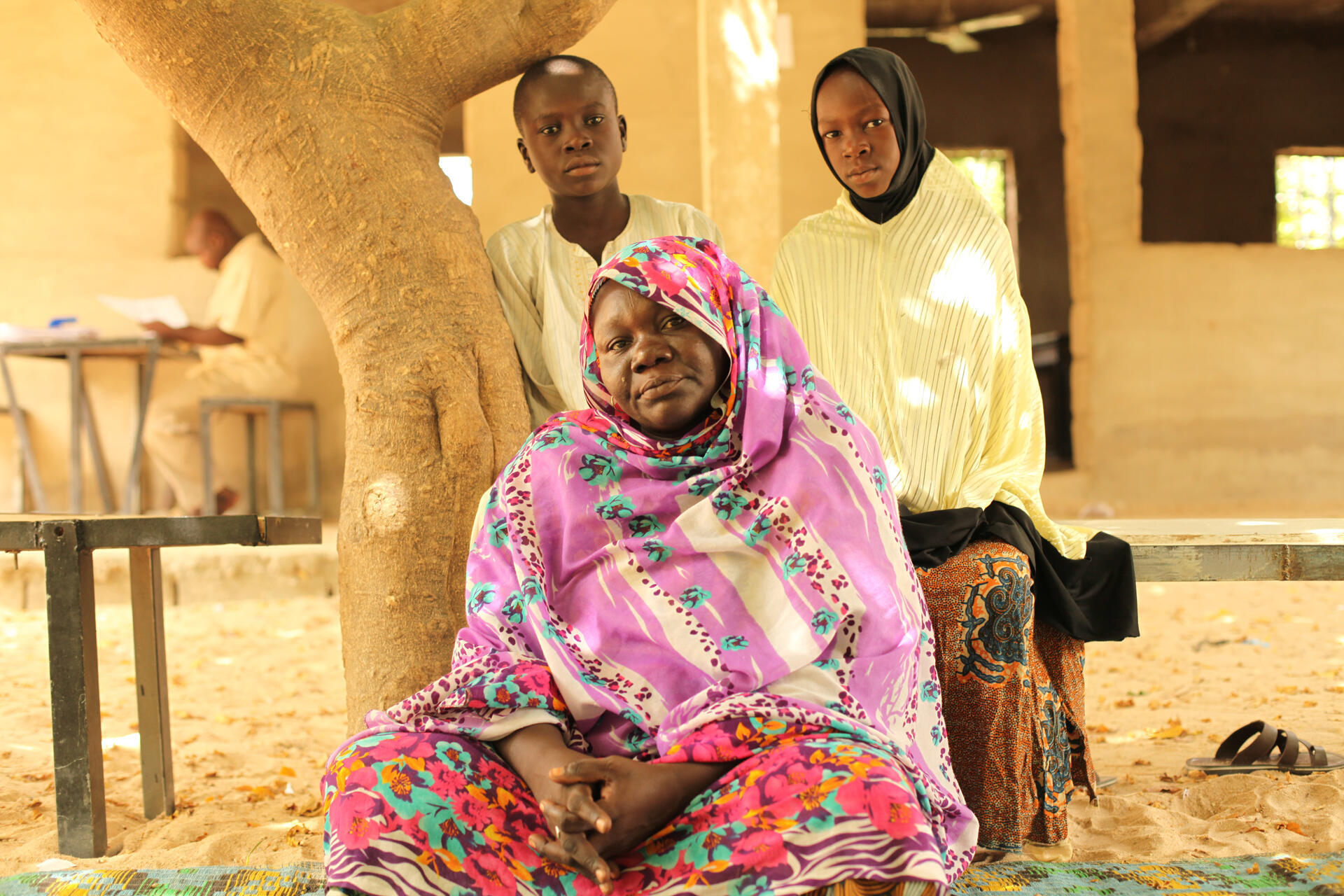 A widow and her two children who attend the Future Prowess Islamic  Foundation.