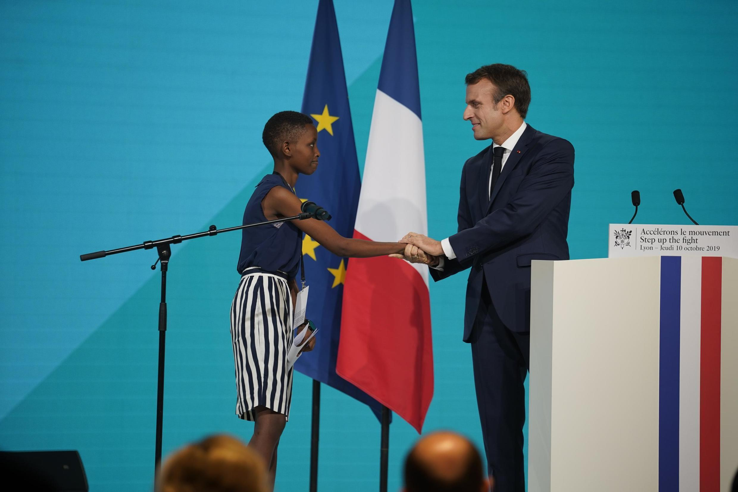 Amanda Dushime from Burundi with Emmanuel Macron, President of France, at the Sixth Global Fund Replenishment Conference in Lyon, 10 October 2019.