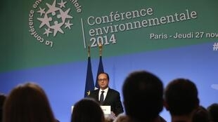 French President Francois Hollande delivers his speech during the Environmental Conference at the Elysee Palace in Paris, 27 November  2014.