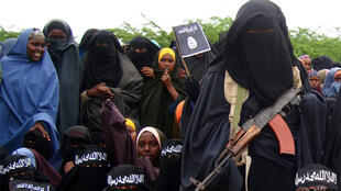 A female Al Shabaab fighter holds her gun during a demonstration against the Amisom in Suqaholaha, north of Mogadishu