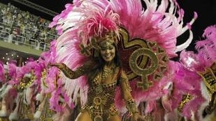 A reveller from the Grande Rio samba school takes part in the second night of the annual Carnival parade in Rio de Janeiro
