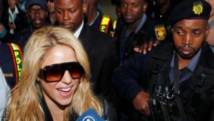 Colombian singer Shakira speaks to the media as she arrives in Johannesburg on 7 June, 2010