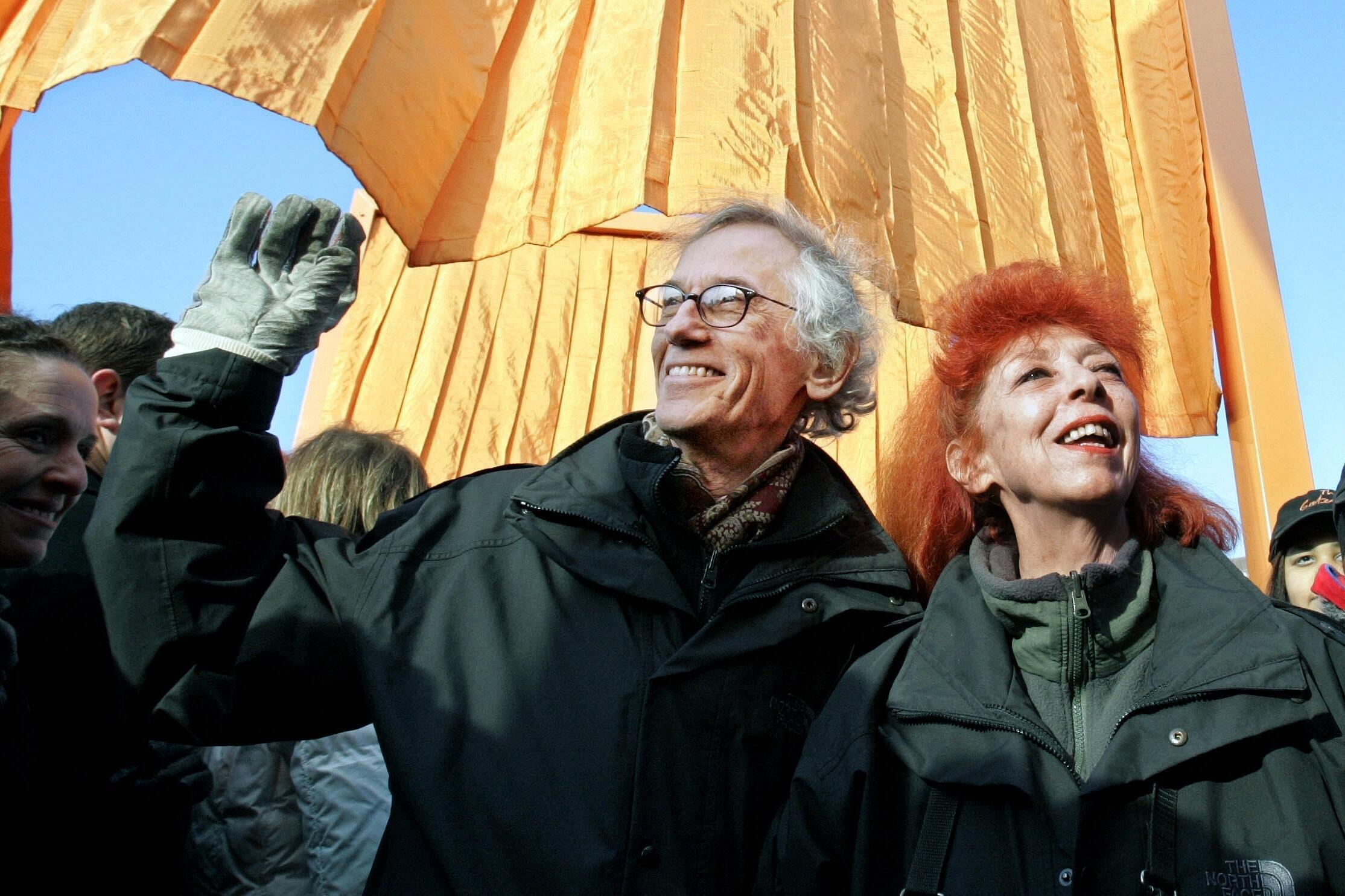 "Christo, left, and his wife and partner Jeanne-Claude, participate in opening ""The Gates"" project in New York's Central Park in 2005."