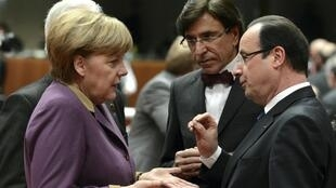 German Chancellor Angela Merkel (L), France's Francois Hollande (R) and Belgium's PM Elio Di Rupo at the Brussels summit