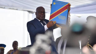 Felix Tshisekedi holds up the constitution during the inauguration ceremony whereby he was sworn into office as the new president of the Democratic Republic of Congo at the Palais de la Nation in Kinshasa, January 24, 2019.